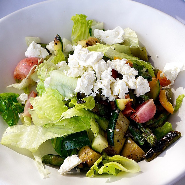 Grilled chopped salad, asparagus, bell pepper, onion, radish, feta cheese, roasted jalapeño sauce