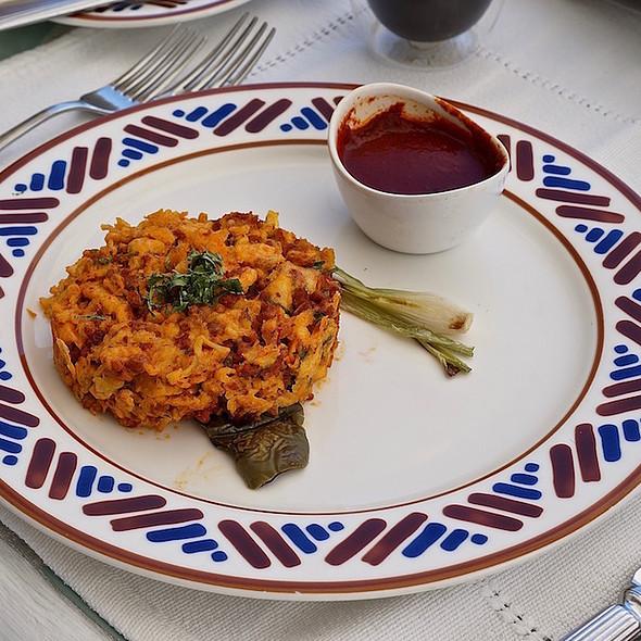Scrambled eggs, local chorizo, cilantro, cactus paddle, spring onions, pasilla chile sauce