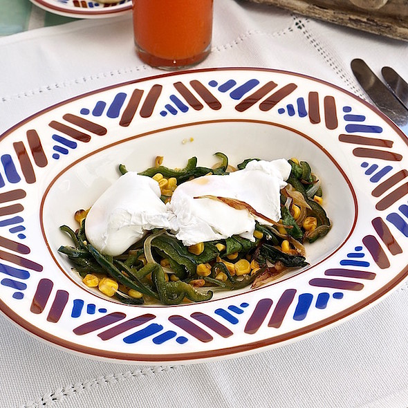 Poached eggs, organic spinach and corn, roasted peppers, poblano cream sauce