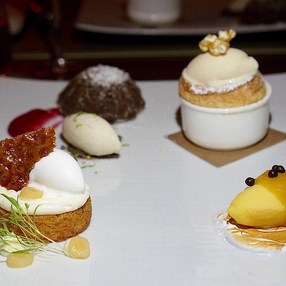Dessert sampler – roasted corn soufflé, chipotle ice cream; brown butter carrot cake, coconut sorbet; passion fruit pavlova; warm chocolate lava cake with vanilla ice cream
