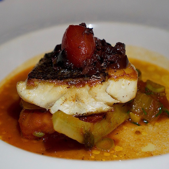 Roasted local sea bass, chermoula sauce, Moroccan olives, sweet peas, lemon preserve @ Agua By Larbi