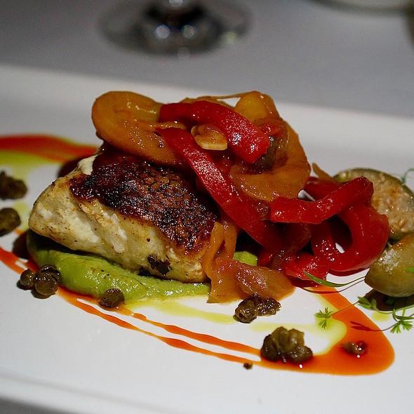Sea bass Veracruz style, pistachio purée, Basquaise sauce, fried capers @ Agua By Larbi