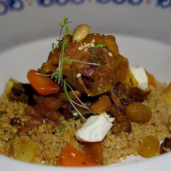 Lamb tajine, Moroccan spices, whole wheat couscous, Golden muscat raisins, onion preserve @ Agua By Larbi