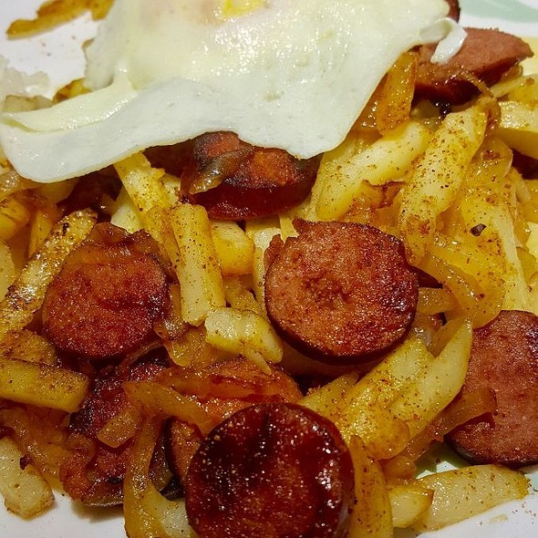Beef Sausage, Fries, Onions with Egg and Rice