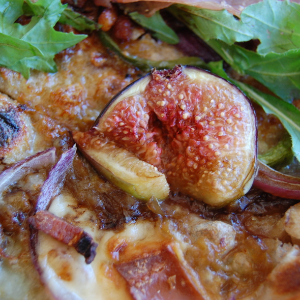 Fig,prosciutto,onion and arugula flatbread. @ Full of Life Flatbread