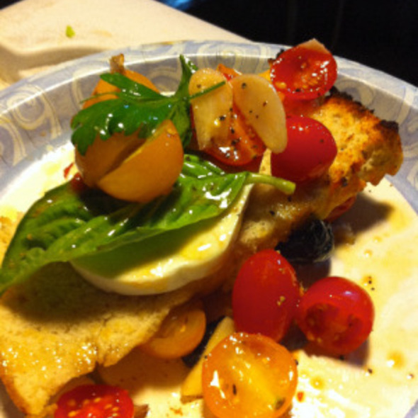Grape Tomato Bruschetta  cured olives, caramelized onions, fresh mozzarella, basil  @ Bacchanal Fine Wine & Spirits