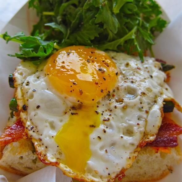 Bacon & Egg Sandwich - asparagus, chile aioli, roasted garlic, mizuna @ Naked Lunch