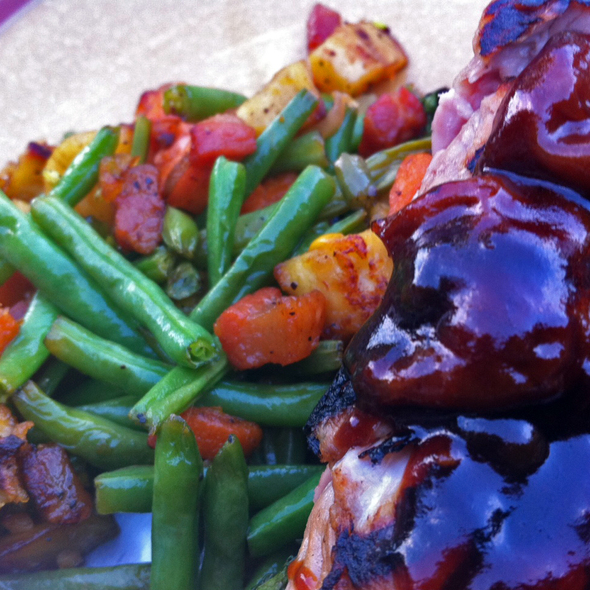 Pork Tenderloin with yams, sweet potatoes, green beans and pancetta with a rich cherry and green peppercorn reduction @ Avalon
