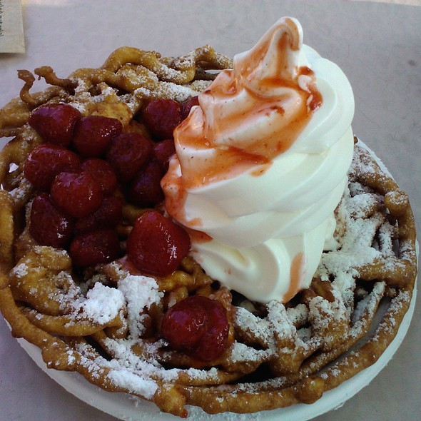 Funnel Cake with ice cream and strawberries