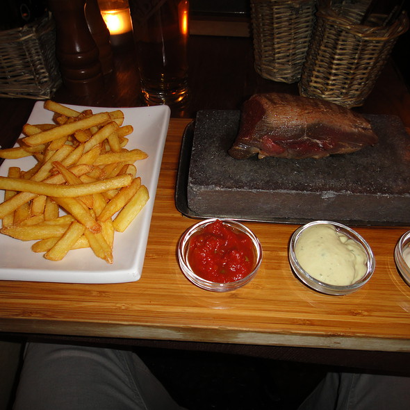 Brasilian Sirloin on lava stone with French Fries @ Rio Grande Restaurant