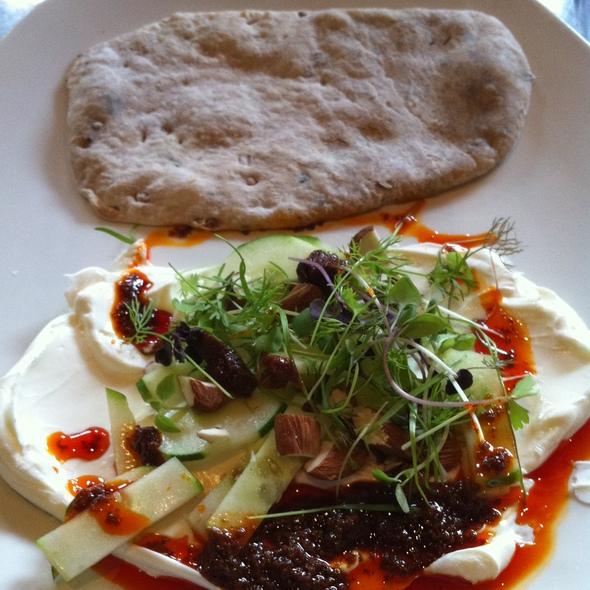 Yogurt cheese with heirloom cucumber, almonds, piquillo pepper vinaigrette, and fresh brick-oven pita @ Revival Bar + Kitchen