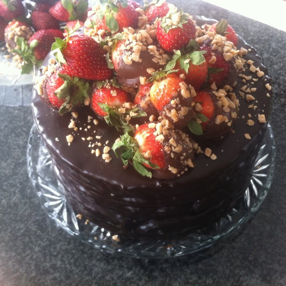 Chocolate Ganache Cake With Strawberries And Chopped Toffee @ Home