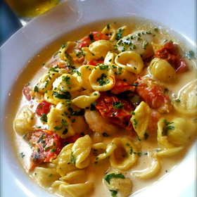 Orecchiette pasta w/scallops,shrimp,lobster & tomatoes in saffron cream