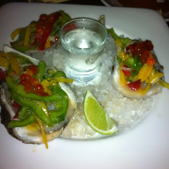 Oysters with shot of vodka @ Ceviche Tapas Bar & Restaurant