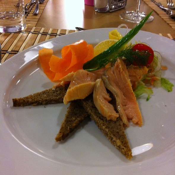 Salmon Fillet Soused With Lemon And Orange Juice. Served With Black Bread