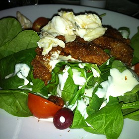 Pecan Crusted Oyster Salad topped with lump crab