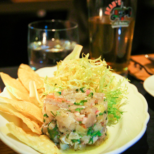 Smoked kingfish ceviche with a friseé salad - Cava, Toronto, ON