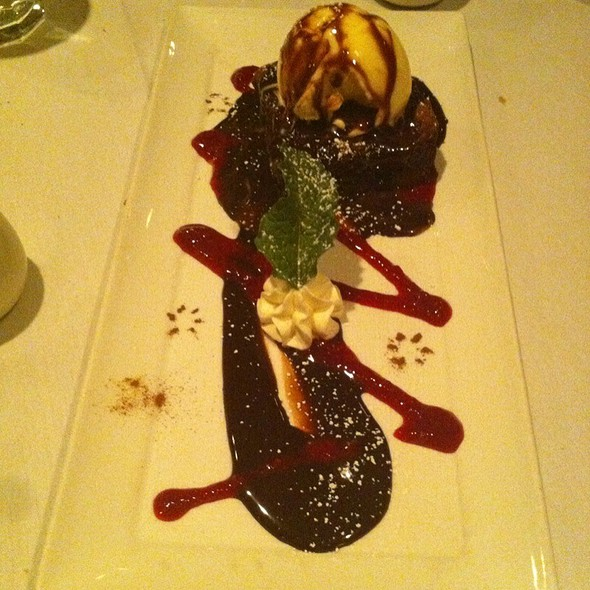 Chocolate Fudge Brownie With Raspberry Sauce And Vanilla Ice Cream - Scusa Italian Ristorante, South Lake Tahoe, CA