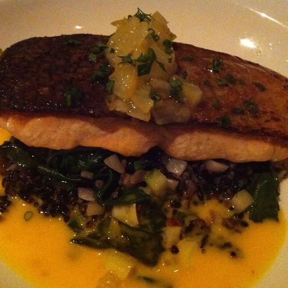 Seared Organic Scottish Salmon With Black Rice, Spinach And Meyer Lemon Reduction - Luma on Park, Winter Park, FL