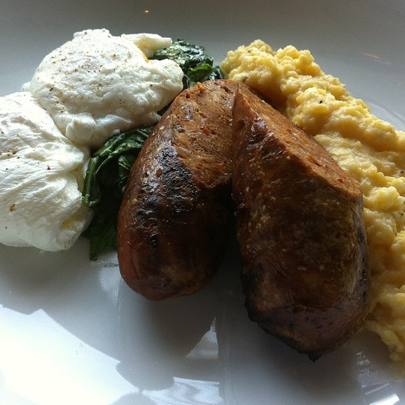 Grilled Chorizo With Spinach And Poached Eggs Over Grits - The Macintosh, Charleston, SC
