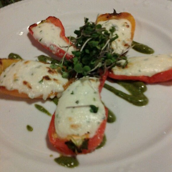 Herb goat cheese stuffed sweet mini peppers with carrot top pesto - The Village Cork, Denver, CO