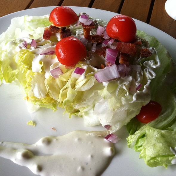 Classic wedge salad, thick cut iceberg, bacon, grape tomatoes, red onion and creamy blue cheese dressing - Columbus Inn, Wilmington, DE