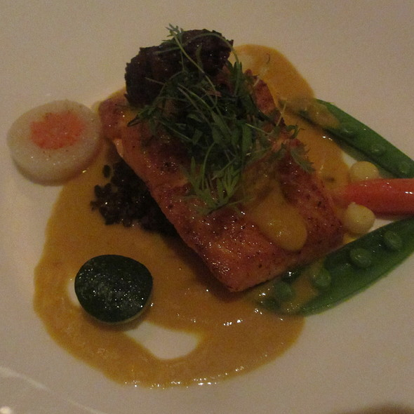 Arctic char with forbidden rice and yellow tomato lemongrass sauce - Les Nomades, Chicago, IL