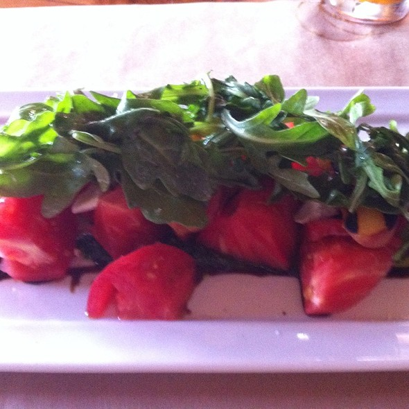 Heirloom Tomato Salad With Ricotta Salata, Grilled Peaches, Arugula, Pesto, And Sicilian Sea Salt - Brick Pizzeria, San Clemente, CA