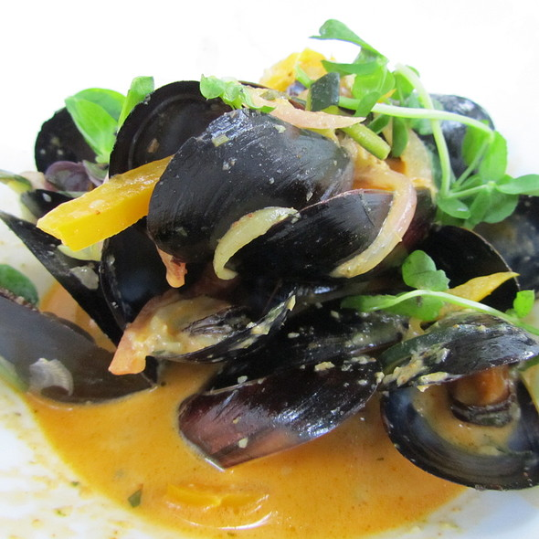 Steamed Mussels with Curry cream sauce and medley of vegetables - La Maquette, Toronto, ON