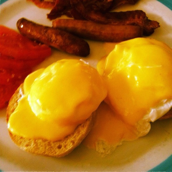Eggs Benedict With Sausage And A Side Of Bacon... - Banana Cafe, Key West, FL