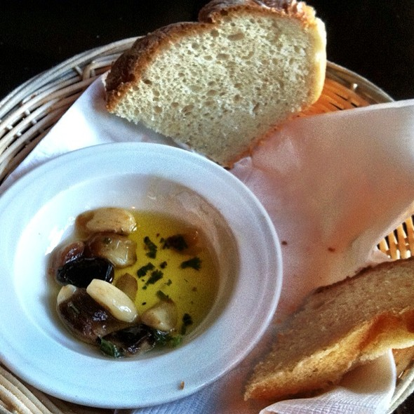 Free Bread And Roasted Garlic Olive Oil Dip With Garlic Ranch Salad - Atasca, Cambridge, MA