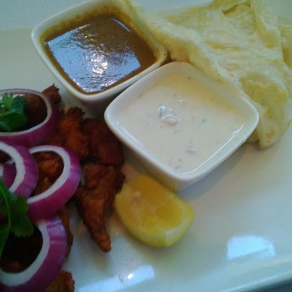 CHICKEN 65 with CEYLON VEECHU PAROTA - Cholanad Restaurant and Bar, Chapel Hill, NC