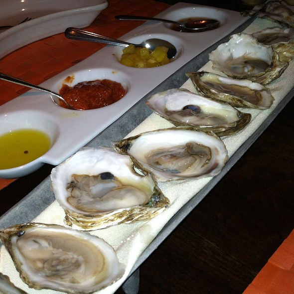 A dozen raw oysters, red onion mignonette, house made cocktail sauce, pineapple tequila vinaigrette - Moro, Wilmington, DE