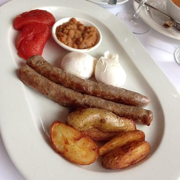 Poached Eggs With Homemade Sausage - Restaurant Lemeac, Montréal, QC