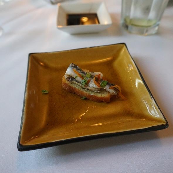 Spanish Bocquerones - marinated white anchovy fillets on a crostini, topped with mandarin orange zest and Italian parsley - Oveja Blanca, Santa Barbara, CA