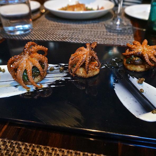 Italian polpa alla Luciana, stewed baby octopus, escarole, pomodorini, capers, olives served on crostini - The Florentine, Chicago, IL