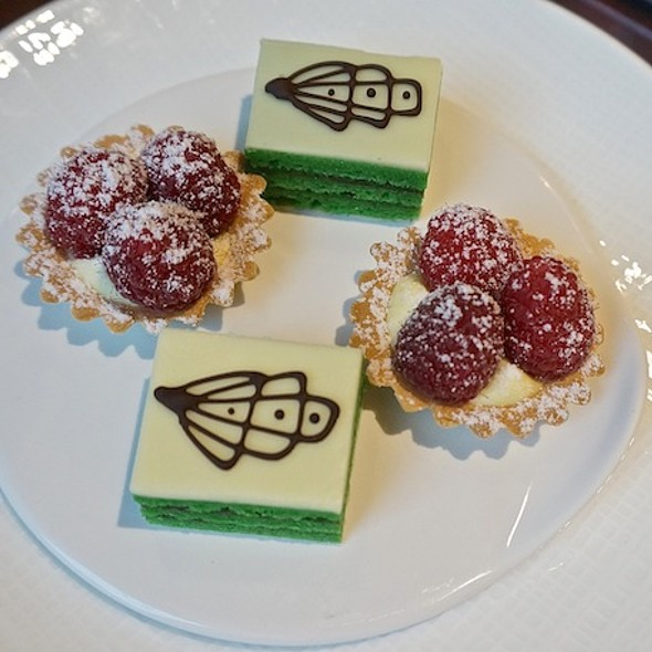 Pistachio petit fours with white chocolate glaze, raspberry vanilla fruit tartlet (afternoon tea) - Allium, Chicago, IL