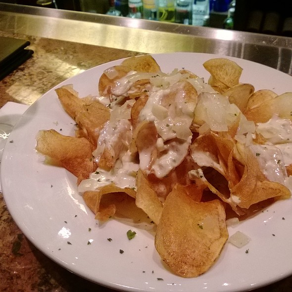 Homemade potato chips with blue cheese and onions - Silver Fox Steakhouse Richardson, Richardson, TX