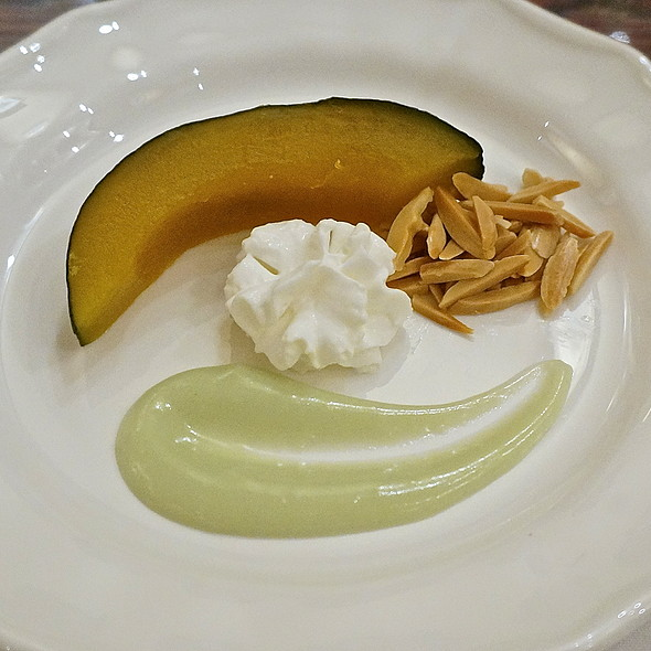 Khong waan – sweet kabocha squash, coconut cream, pandan sauce, almond flakes (Thai food dessert) - Arun's Thai Restaurant, Chicago, IL