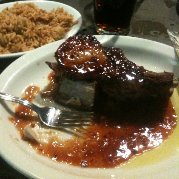Double Rib Pork Chop With Pomegranate Reduction Sauce - Rock Bottom Brewery Restaurant - Cincinnati, Cincinnati, OH