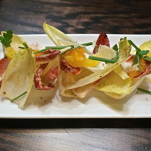 Endive salad, wild citrus, parmigiano reggiano, anchovy vinaigrette - Balena Italian - Temporarily Closed, Chicago, IL