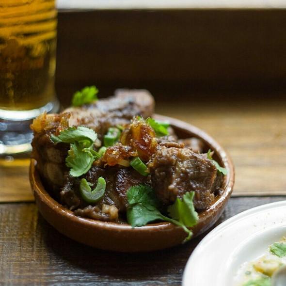 Iberico pork ribs, grelot and date sauce - Copita, London