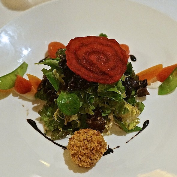 Artisan greens, marinated vegetables, hazelnut crusted goat cheese, balsamic vinaigrette, beet chip - Les Nomades, Chicago, IL