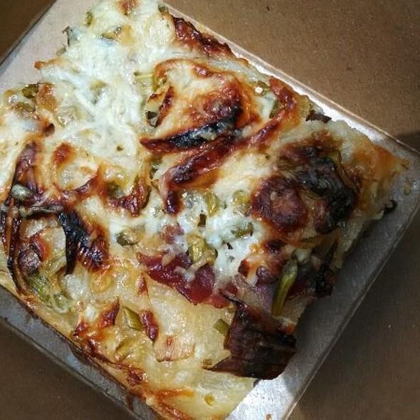 garlic scape, onion, prosciutto and cheese focaccia - Heartland Restaurant, Saint Paul, MN