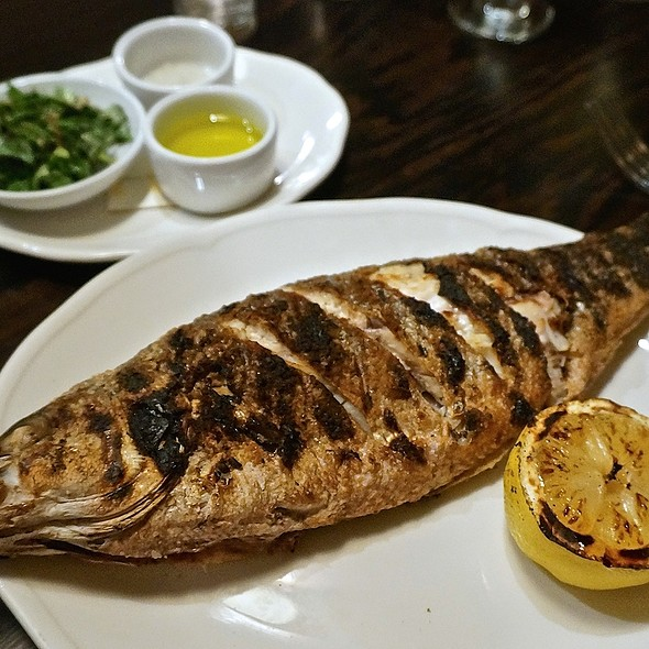 Whole roasted wild striped bass, mint parsley tarragon herb salad, grilled lemon - Balena Italian - Temporarily Closed, Chicago, IL