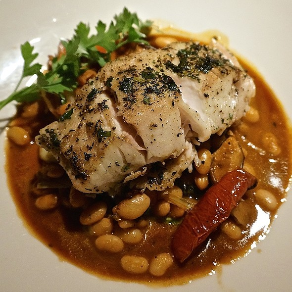 Herb-crusted wild sea bass, great northern white beans, bacon, spinach, shiitake mushrooms, oven-dried tomatoes, roasted garlic cream sauce - Grasing's, Carmel, CA