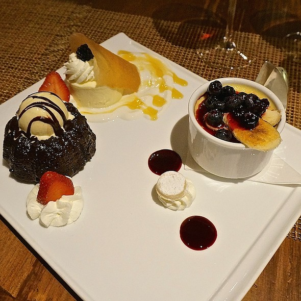 Dessert platter – goat cheese cheesecake with honey yogurt; molten chocolate cake with vanilla ice cream; maple crème brulée, blueberry compote, caramelized plantains - Luminaria Restaurant & Patio, Santa Fe, NM