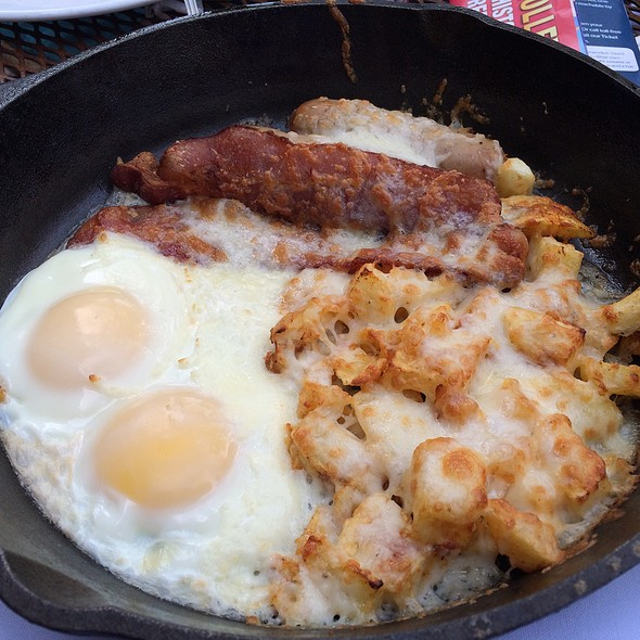Skillet Breakfast, Applewood Smoked Bacon, Maple Sausage, Home Fries, Eggs and Cheddar Cheese Baked in a Cast Iron Skillet - Stephanie's On Newbury, Boston, MA