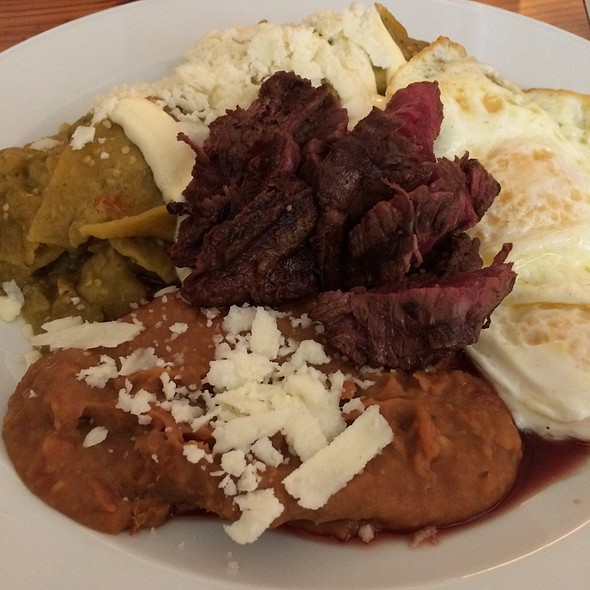 Chilaquiles Verdes With Poached Eggs, Hangar Steak, And Refried Beans ...