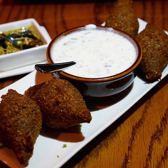 Kebbe kras - Lebanon's nationa dish, lean beef and crack wheat filled with ground beef, diced onions and pine nuts; laban yogurt sauce - Balade, New York, NY